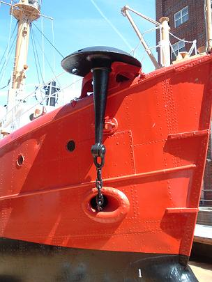 Mushroom anchor held in chock on starboard bow